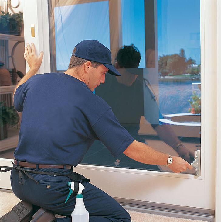 Man-applying-window-film2