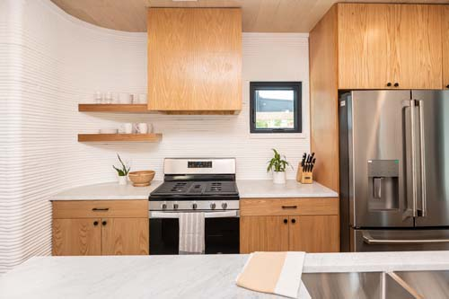 3Strands_ICON_FirstMainstream_3D-printed_Homes_Sold_In_America_Aug2021_Unit_2_Kitchen