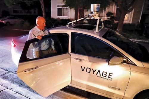 senior in self driving car